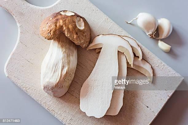 Boletus edulis mushroom on cutting board