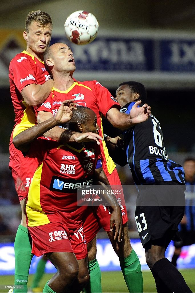 Boli Bolingoli Mbombo of Club Brugge battles for the ball with Michiel Jonkheere of KV Oostende, Frederic Brillant of KV Oostende and Xavier Luissint of KV Oostende during the Jupiler Pro League match between KV Oostende and Club Brugge KV on August 4, 2013 in Oostende, Belgium. (Photo by Peter De Voecht/Photonews