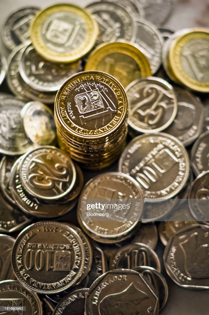 Bolivar coins are arranged for a photograph in Caracas, Venezuela, on Wednesday, Feb. 13, 2013. Venezuelan President Hugo Chavez, who hasn't been seen or heard from publicly since arriving in Havana on Dec. 10 for cancer surgery, ordered his government to weaken the exchange rate by 32 percent to 6.3 bolivars per dollar starting on Feb. 13. Photographer: Meridith Kohut/Bloomberg via Getty Images