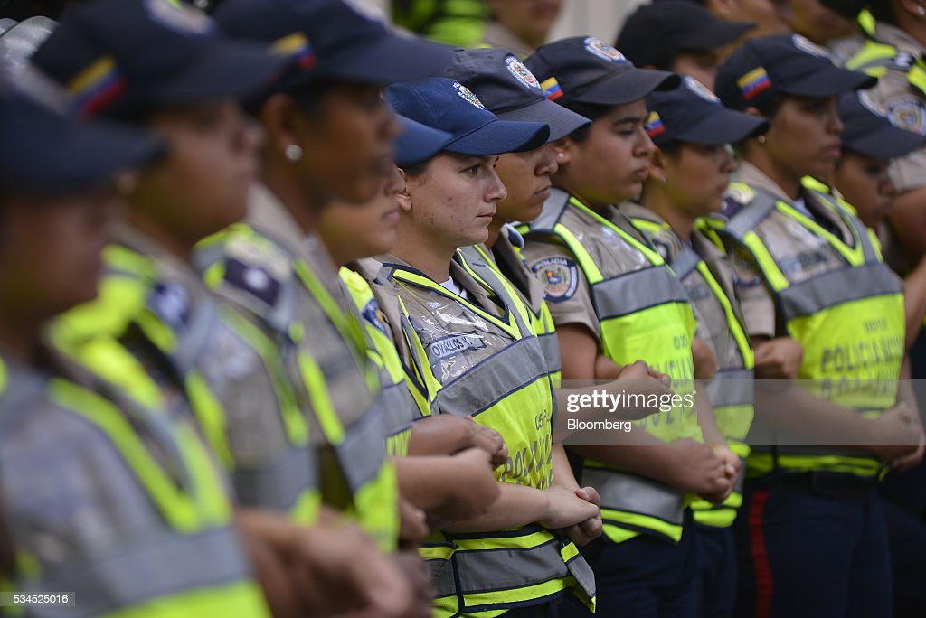 Bolivarian National Police stand guard near the Central University of Venezuela during pro-opposition students marching near the Central University of Venezuela in Caracas, Venezuela, on Thursday, May 26, 2016. The opposition is pushing for a recall referendum on President Nicolas Maduro and blame the 53-year-old leader for widespread shortages of food and basic necessities. Photographer: Carlos Becerra/Bloomberg via Getty Images