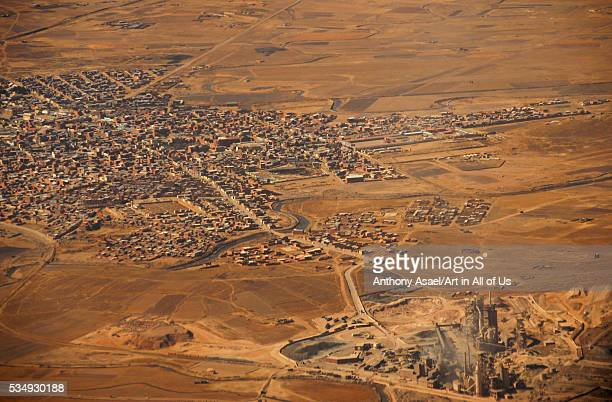 Bolivia, Inland, aerial view of congested residential structures amid barren landscape