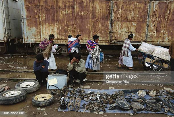 Bolivia, La Paz, El Alto, man selling machine parts on railway siding