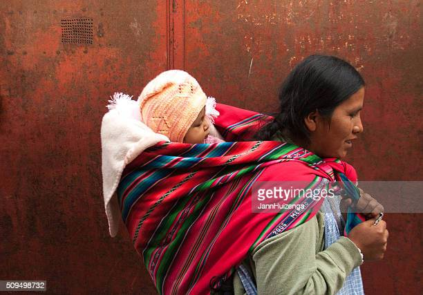 Bolivia: Quechua Woman with Baby on Back, Red Background (Close-Up)