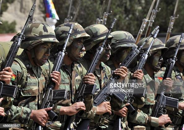 Bolivian army soldiers parade during the celebration of the 123rd Anniversary of the Military School in La Paz on April 25 2014 Bolivia sacked 702...