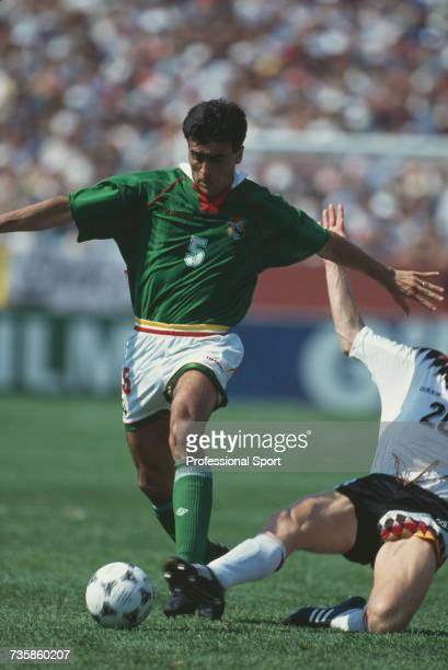 Bolivian footballer Gustavo Quinteros pictured in action with the ball as he is tackled by German midfielder Stefan Effenberg in the 1994 FIFA World...