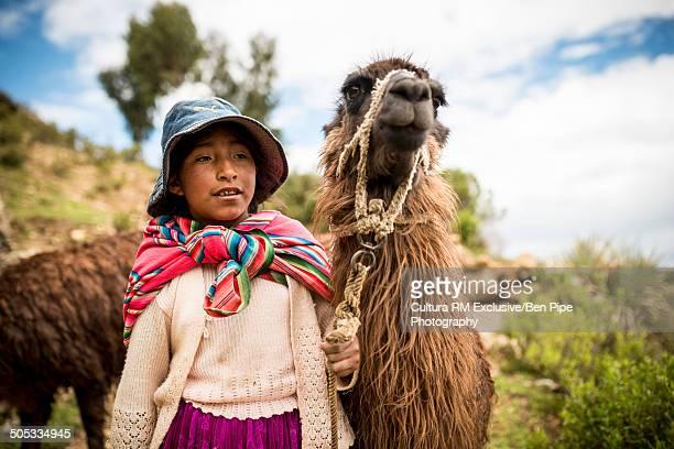 Bolivian girl with llama, Isla del Sol, Lake Titicaca, Bolivia