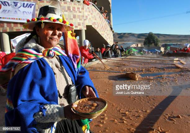 Bolivian indigenous woman holds a traditional soup dish named Kalapari during the celebration of the AndeanAmazonic New Year 5525 on June 21 2017 in...