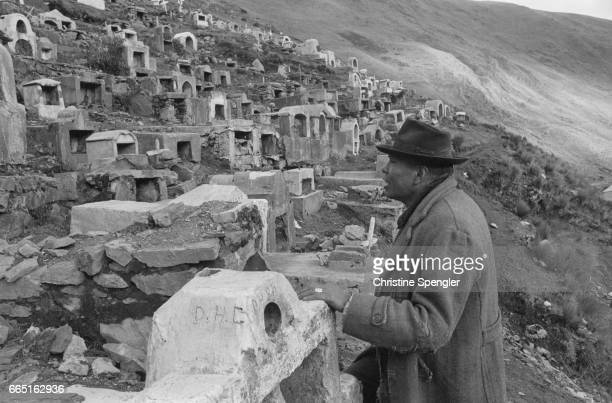 A Bolivian man visits a cemetery used by the Siglo XX mining company