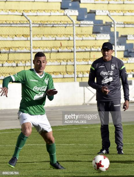 Bolivian national football team coach Mauricio Soria looks at player Pablo Escobar during a training session in La Paz on March 21 2017 Bolivia will...
