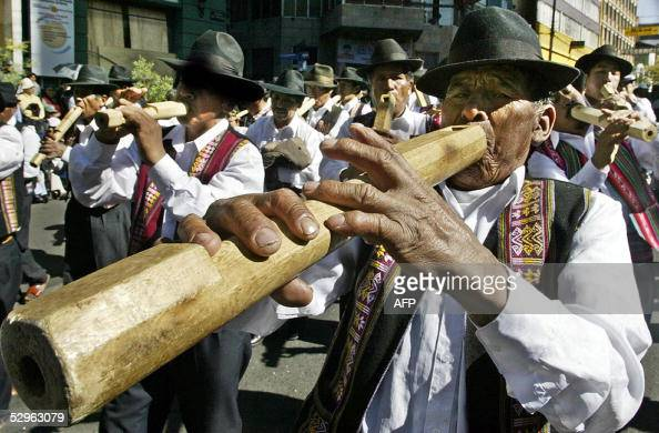 Bolivian native plays a traditional wind instrument 21 May 2005 in La Paz during the celebration of 'Jesus Senor del Gran Poder' festivity About...