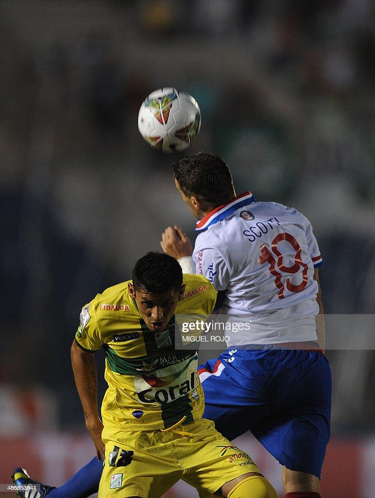 Bolivian Oriente Petrolero's Yasmani Duk vies for the ball with Andres Scotti of Uruguayan Nacional during their Libertadores Cup football match at...
