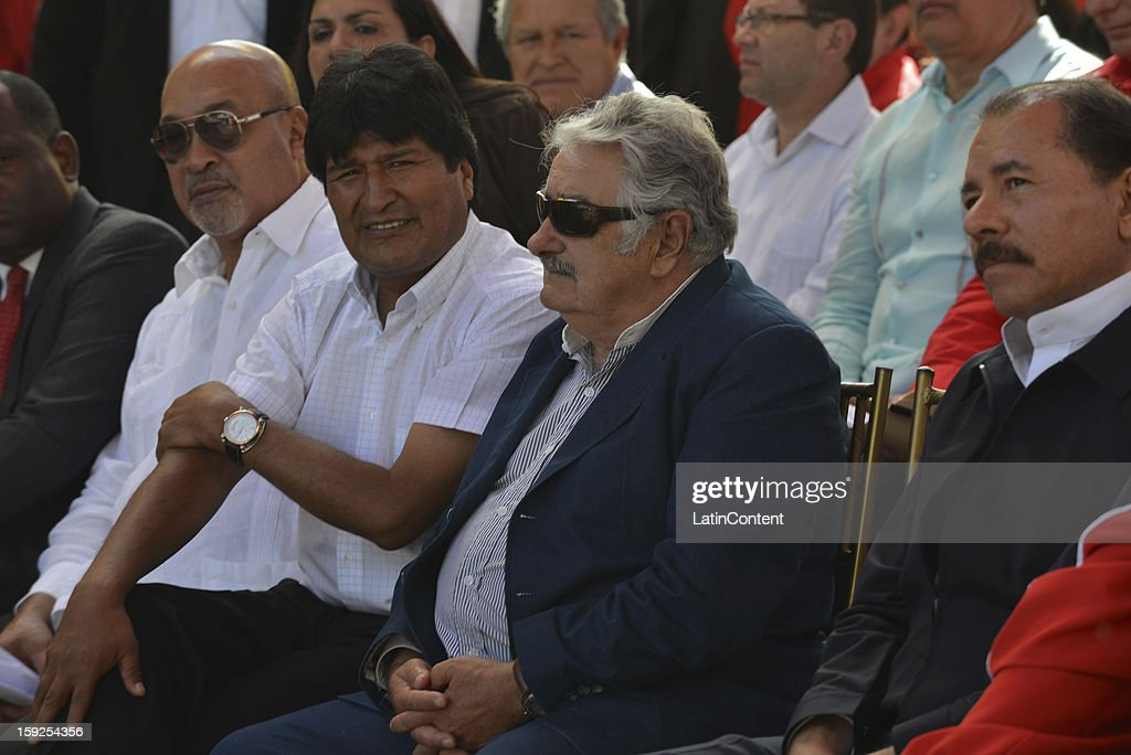 Bolivian Persident <a gi-track='captionPersonalityLinkClicked' href=/galleries/search?phrase=Evo+Morales&family=editorial&specificpeople=272981 ng-click='$event.stopPropagation()'>Evo Morales</a> Ayma (L) and Uruguayan Pesident <a gi-track='captionPersonalityLinkClicked' href=/galleries/search?phrase=Jose+Mujica&family=editorial&specificpeople=637688 ng-click='$event.stopPropagation()'>Jose Mujica</a> during a meeting to support Hugo Chavez at Miraflores Presidential Palace on January 10, 2013 in Caracas, Venzuela. Chavez is now hospitalized in Cuba due to a cancer. Meanwhile, his followers back him up in the day a new presidential term is inaugurated without him. People make their way to Miraflores Presidential Palace to witness a symbolic swearing-in.
