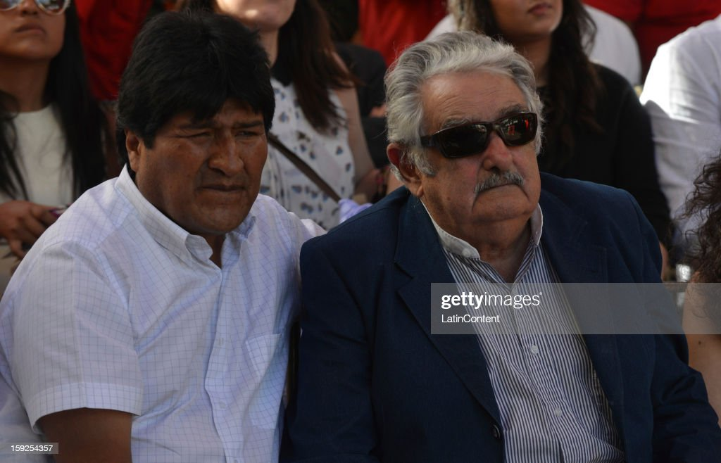 Bolivian Persident <a gi-track='captionPersonalityLinkClicked' href=/galleries/search?phrase=Evo+Morales&family=editorial&specificpeople=272981 ng-click='$event.stopPropagation()'>Evo Morales</a> Ayma (L) and Uruguayan Pesident Jose Mujica during a meeting to support Hugo Chavez at Miraflores Presidential Palace on January 10, 2013 in Caracas, Venzuela. Chavez is now hospitalized in Cuba due to a cancer. Meanwhile, his followers back him up in the day a new presidential term is inaugurated without him. People make their way to Miraflores Presidential Palace to witness a symbolic swearing-in.