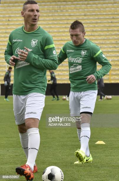 Bolivian players Alejandro Chumacero and Pablo Escobar take part in a training session on March 27 at the Hernando Siles stadium in La Paz Bolivia...