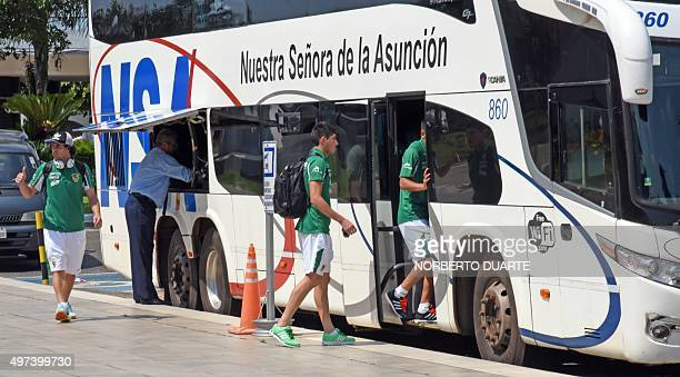 Bolivian players board a bus upon their arrival at Silvio Pettirossi international airport in Luque Paraguay on November 16 2015 Bolivia will face...