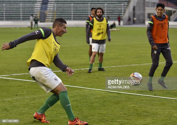 Bolivian players Pablo Escobar Fernando Martelli and Ramiro Vaca take part in a training session at the Hernando Siles stadium in La Paz on March 24...