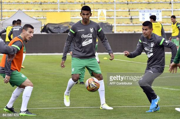 Bolivian players Pablo Escobar Gilbert Alvarez and Juan Carlos Arce take part in a training session by the Bolivian national football team on...