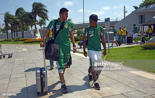 Bolivian players Ronald Eguino and Gustavo Pinedo are seen upon their arrival at Silvio Pettirossi international airport in Luque Paraguay on...