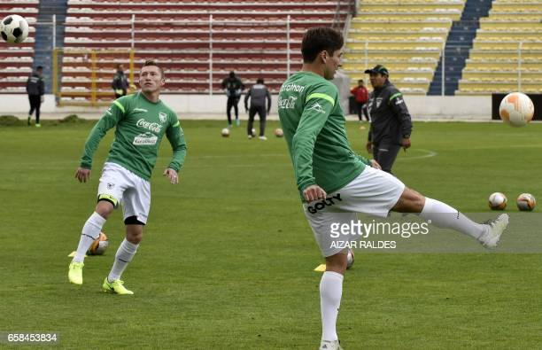 Bolivian players Ronald Raldes and Alejandro Chumacero take part in a training session on March 27 at the Hernando Siles stadium in La Paz Bolivia...