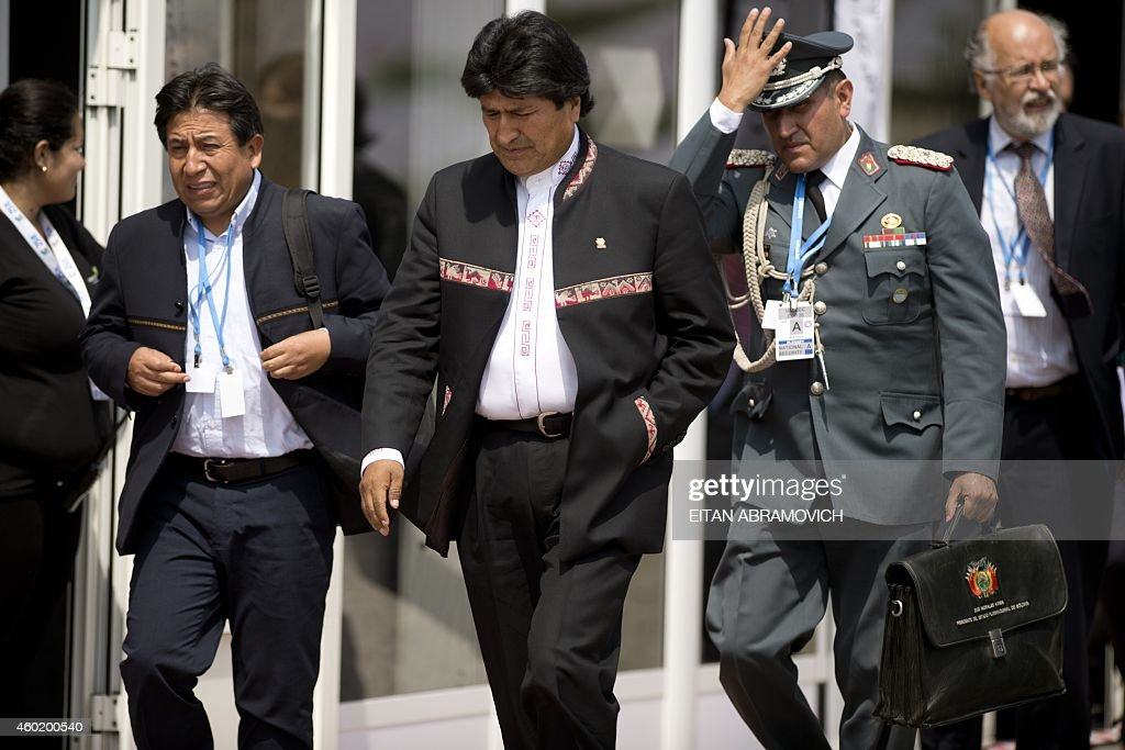 Bolivian President <a gi-track='captionPersonalityLinkClicked' href=/galleries/search?phrase=Evo+Morales&family=editorial&specificpeople=272981 ng-click='$event.stopPropagation()'>Evo Morales</a> (C), accompanied by his Foreign Minister <a gi-track='captionPersonalityLinkClicked' href=/galleries/search?phrase=David+Choquehuanca&family=editorial&specificpeople=589843 ng-click='$event.stopPropagation()'>David Choquehuanca</a> (L), heads to a press conference during the UN COP20 and CMP10 climate change conferences being held in Lima, on December 9, 2014. The UN 20th session of the Conference of the Parties on Climate Change (COP20), and the 10th session of the Conference of the Parties serving as the Meeting of the Parties to the Kyoto Protocol (CMP10) entered its second week of negotiations until 12th. AFP PHOTO/Eitan Abramovich. AFP PHOTO / EITAN ABRAMOVICH