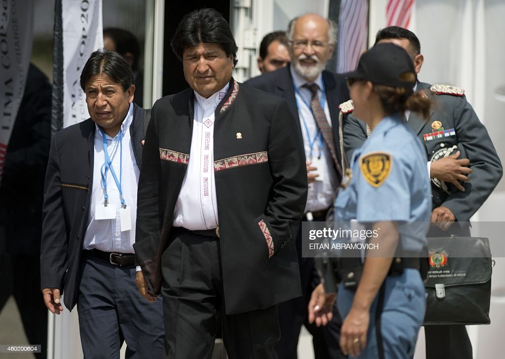 Bolivian President <a gi-track='captionPersonalityLinkClicked' href=/galleries/search?phrase=Evo+Morales&family=editorial&specificpeople=272981 ng-click='$event.stopPropagation()'>Evo Morales</a> (C), accompanied by his Foreign Minister <a gi-track='captionPersonalityLinkClicked' href=/galleries/search?phrase=David+Choquehuanca&family=editorial&specificpeople=589843 ng-click='$event.stopPropagation()'>David Choquehuanca</a> (L), heads to a press conference during the UN COP20 and CMP10 climate change conferences being held in Lima, on December 9, 2014. The UN 20th session of the Conference of the Parties on Climate Change (COP20), and the 10th session of the Conference of the Parties serving as the Meeting of the Parties to the Kyoto Protocol (CMP10) entered its second week of negotiations until 12th. AFP PHOTO/Eitan Abramovich.