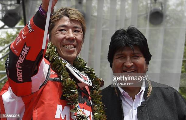 Bolivian President Evo Morales and Japanese biker Jun Mitsuhashi on the podium at the end of the Stage 5 of the Dakar Rally 2016 between Jujuy in...