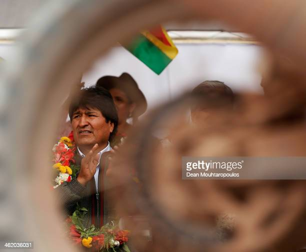 Bolivian President Evo Morales Ayma applauds the riders on the podium during Day 8 of the 2014 Dakar Rally on January 12 2014 in Uyuni Bolivia