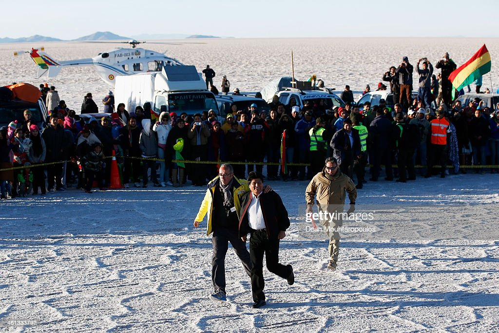 Bolivian President, <a gi-track='captionPersonalityLinkClicked' href=/galleries/search?phrase=Evo+Morales&family=editorial&specificpeople=272981 ng-click='$event.stopPropagation()'>Evo Morales</a> Ayma arrives via helicopter to start the race during day 8 of the Dakar Rallly on the Salar de Uyuni or Uyuni Salt Flats on January 11, 2015 in Uyuni, Bolivia.