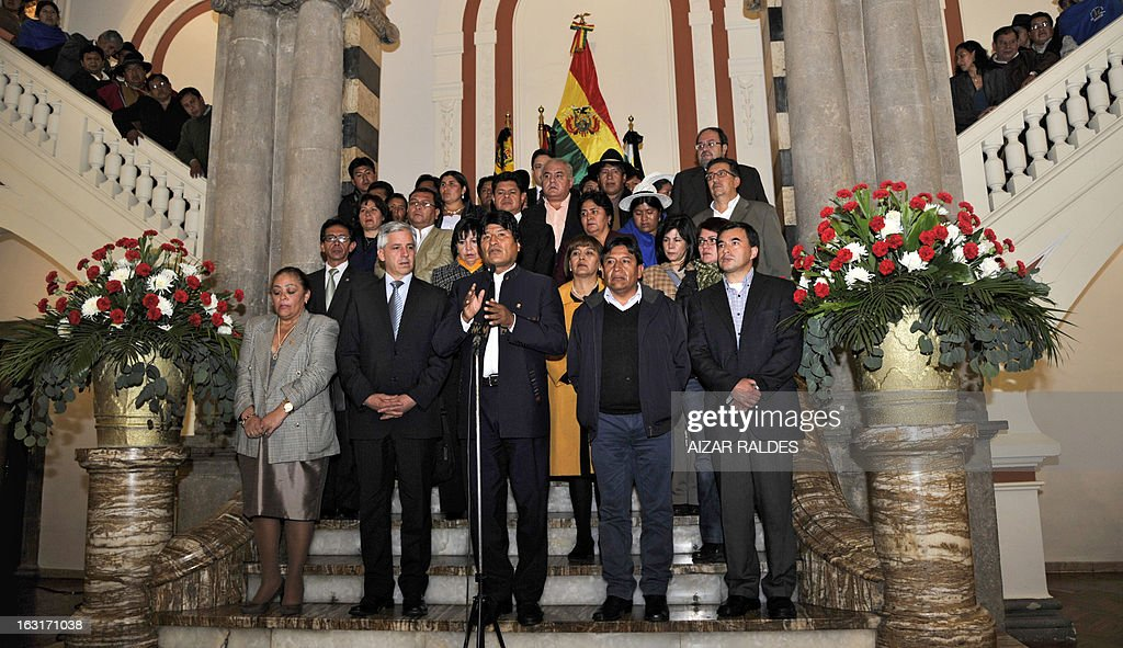 Bolivian President Evo Morales Ayma (C) delivers a press conference to offer condolences after hearing of Venezuelan President Hugo Chavez's death on March 5, 2013 in La Paz. AFP PHOTO/Aizar Raldes