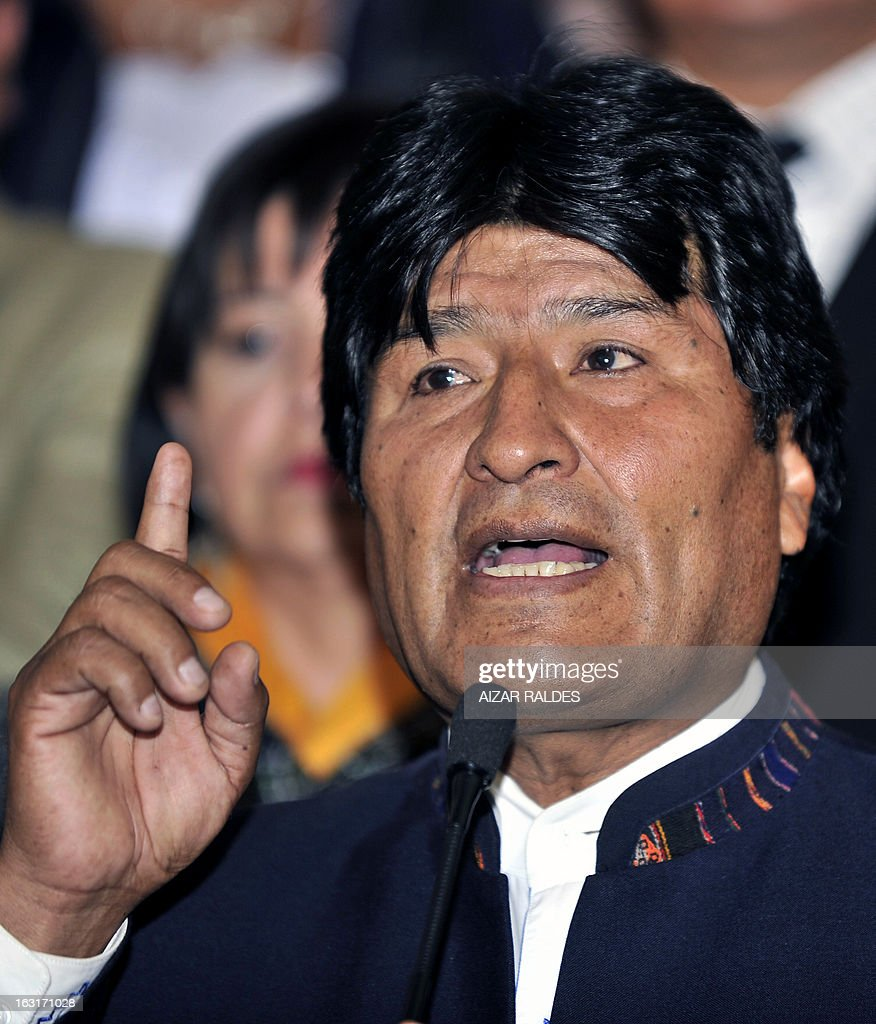 Bolivian President Evo Morales Ayma delivers a speech to offer condolences after hearing of Venezuelan President Hugo Chavez's death, at the Quemado palace in La Paz, on March 5, 2013. AFP PHOTO/Aizar Raldes