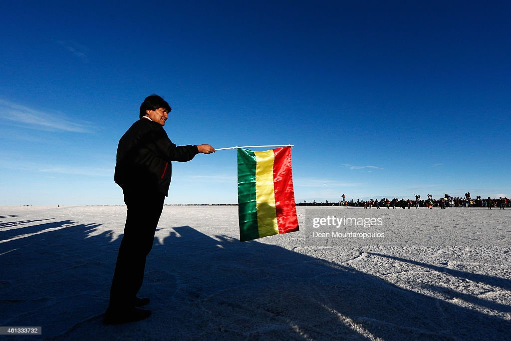 Bolivian President, <a gi-track='captionPersonalityLinkClicked' href=/galleries/search?phrase=Evo+Morales&family=editorial&specificpeople=272981 ng-click='$event.stopPropagation()'>Evo Morales</a> Ayma gets ready to wave a Bolivia flag to start the race during day 8 of the Dakar Rallly on the Salar de Uyuni or Uyuni Salt Flats on January 11, 2015 in Uyuni, Bolivia.
