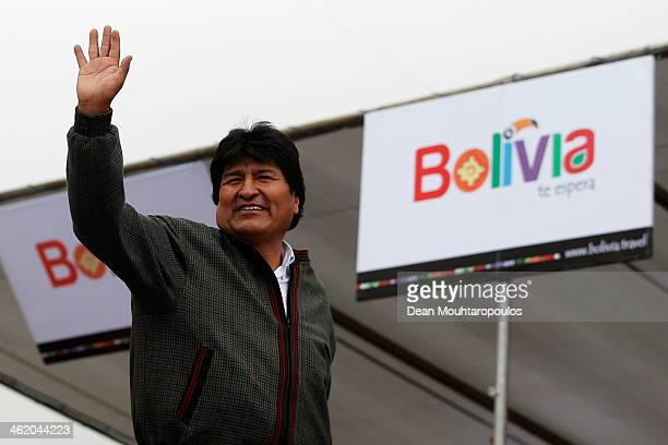 Bolivian President Evo Morales Ayma waves to the media and fans from the podium during Day 8 of the 2014 Dakar Rally on January 12 2014 in Uyuni...