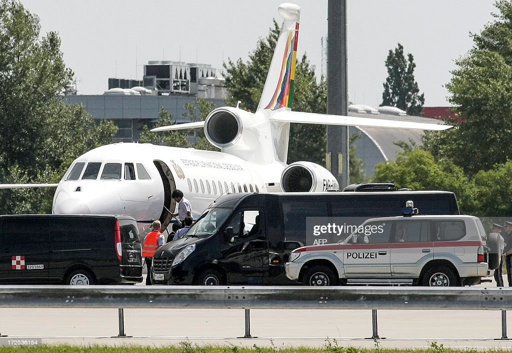 Bolivian President Evo Morales boards his plane prior leaving the Vienna International Airport on July 3, 2013. Bolivian President Evo Morales angrily denied any wrongdoing on Wednesday after his plane was diverted to Vienna over suspicion fugitive US intelligence leaker Edward Snowden was on board.