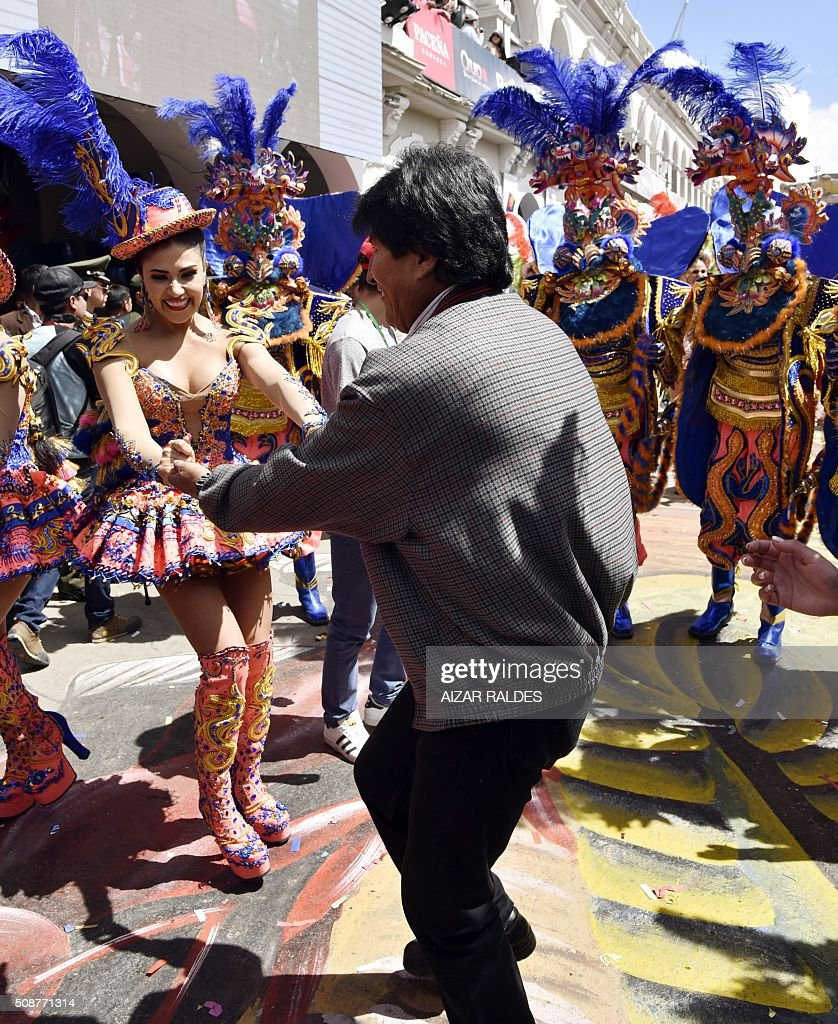 Bolivian President Evo Morales dances with a member of the Morenada Zona Norte fraternity during the Carnival of Oruro, in this Bolivian city, 240 km south of La Paz, on February 6, 2016. The Carnival of Oruro is a UNESCO Masterpiece of the Oral and Intangible Heritage of Humanity. AFP PHOTO/AIZAR RALDES / AFP / AIZAR RALDES