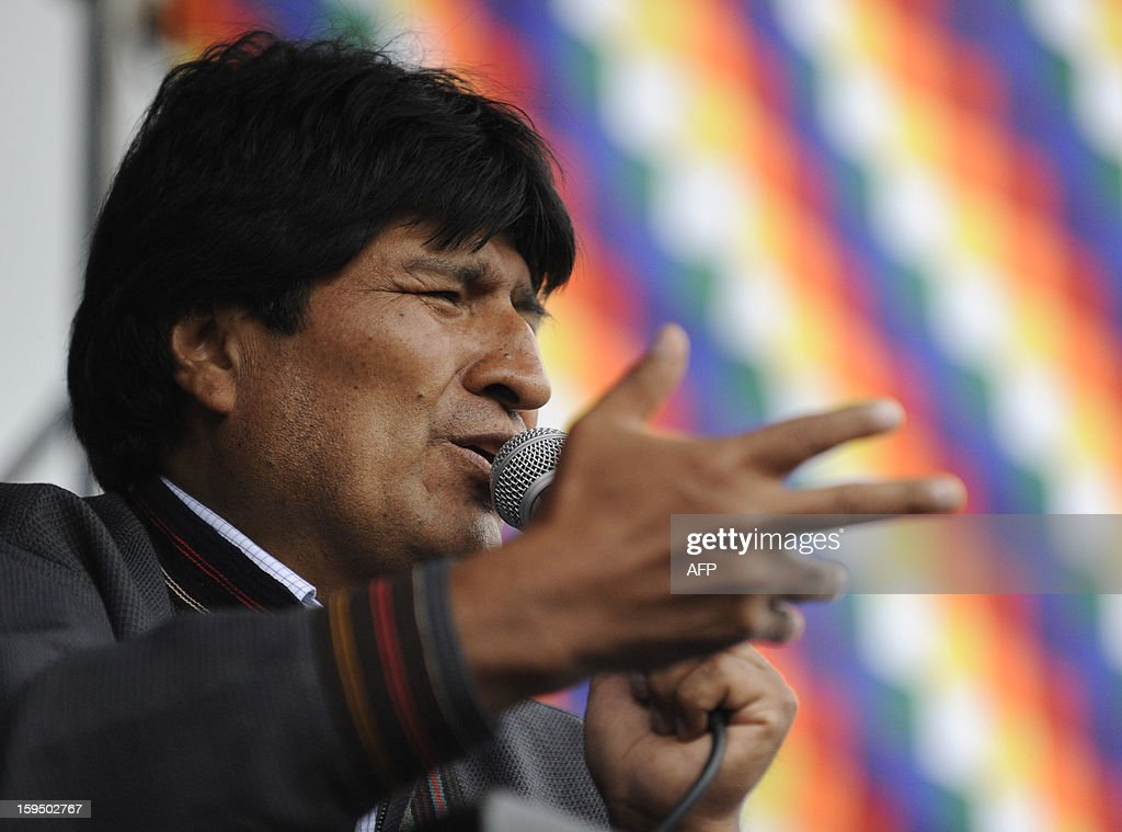 Bolivian President Evo Morales delivers a speech during the celebration for the reincorporation of Bolivia to the UN Convention Against Illicit Traffic in Narcotic Drugs in La Paz on January 14, 2013. 'The coca leaf is not any more seen as cocaine (..), it is a victory of our identity' said Morales. AFP PHOTO/Jorge Bernal