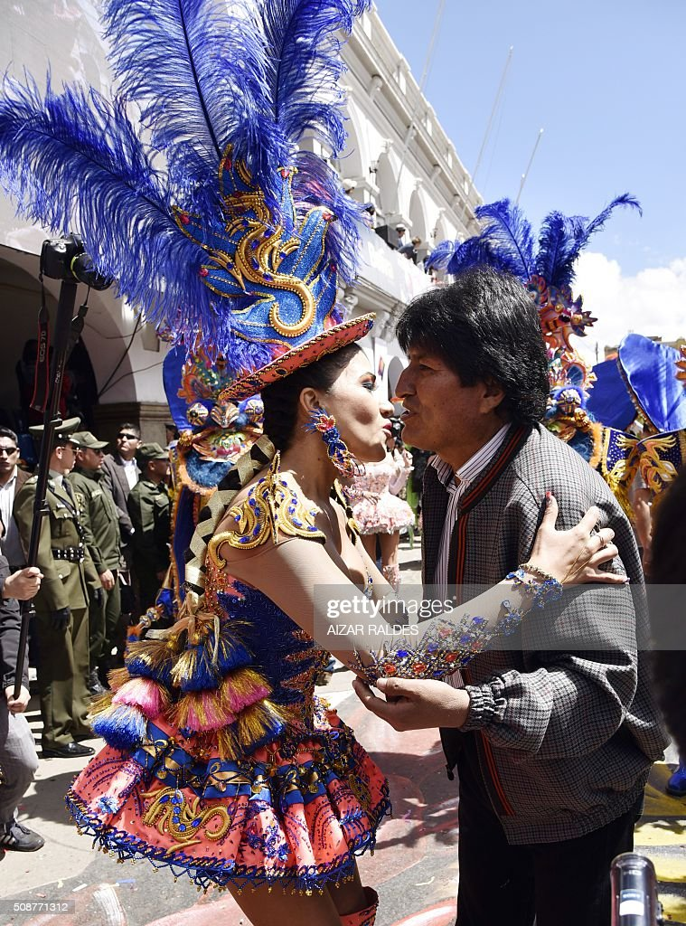 Bolivian President Evo Morales (R) greets a member of the Morenada Zona Norte fraternity during the Carnival of Oruro, in this Bolivian city, 240 km south of La Paz, on February 6, 2016. The Carnival of Oruro is a UNESCO Masterpiece of the Oral and Intangible Heritage of Humanity. AFP PHOTO/AIZAR RALDES / AFP / AIZAR RALDES