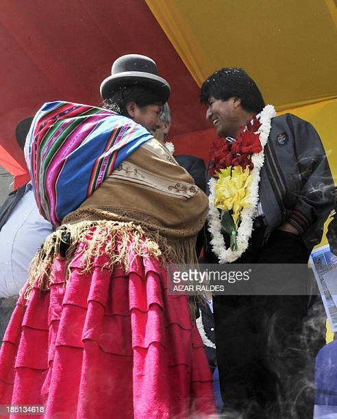 Bolivian President Evo Morales is greeted bya an Aymara indigenous woman during the ceremonies commemorating the 10th anniversary of the indigenous...