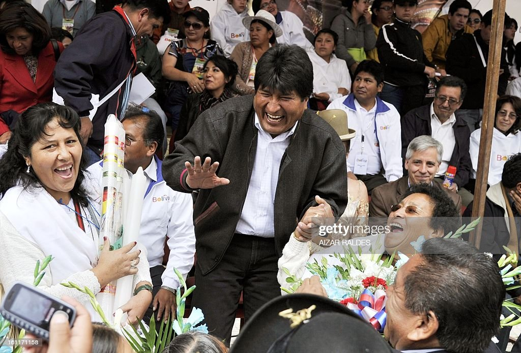 Bolivian President Evo Morales laughs during the Carnival of Oruro, in the mining town of Oruro, 240 km south of La Paz on February 9, 2013. The Carnival of Oruro was inscribed by UNESCO on the Representative List of the Intangible Cultural Heritage of Humanity in 2008.