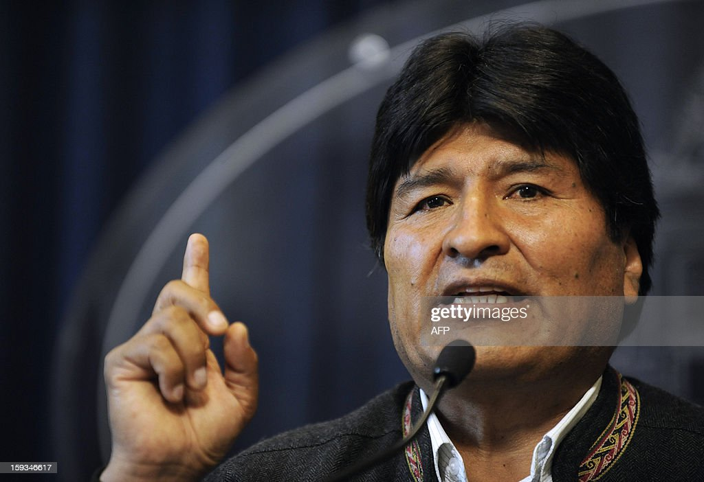 Bolivian President Evo Morales offers a press conference at the presidential palace in La Paz on January 12, 2013 a day after Bolivia was allowed to return to the United Nations' main anti-narcotics treaty, after winning an opt-out allowing its population to keep chewing coca leaves. Bolivia withdrew from the UN Convention on Narcotic Drugs last year in protest over the coca leaf being labeled an illegal drug. While the leaf is the raw ingredient for cocaine, chewing coca leaves is a centuries' old tradition in Bolivia.