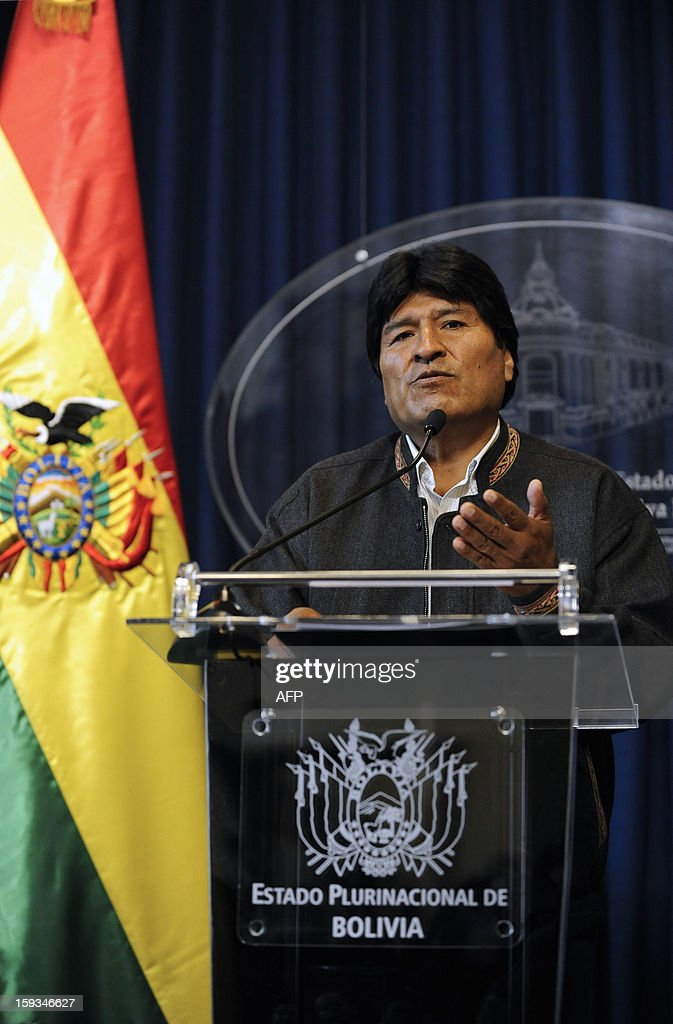 Bolivian President Evo Morales offers a press conference at the presidential palace in La Paz on January 12, 2013 a day after Bolivia was allowed to return to the United Nations' main anti-narcotics treaty, after winning an opt-out allowing its population to keep chewing coca leaves. Bolivia withdrew from the UN Convention on Narcotic Drugs last year in protest over the coca leaf being labeled an illegal drug. While the leaf is the raw ingredient for cocaine, chewing coca leaves is a centuries' old tradition in Bolivia. AFP PHOTO/JORGE BERNAL