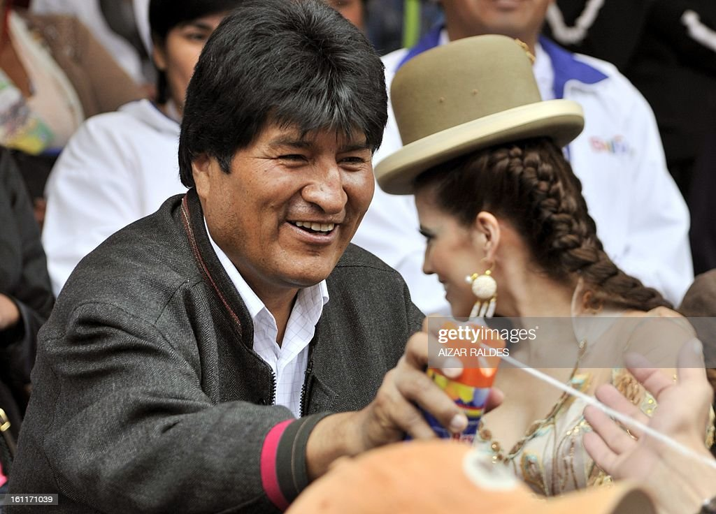 Bolivian President Evo Morales shoots aerosol string at revelers during the Carnival of Oruro, in the mining town of Oruro, 240 km south of La Paz on February 9, 2013. The Carnival of Oruro was inscribed by UNESCO on the Representative List of the Intangible Cultural Heritage of Humanity in 2008.