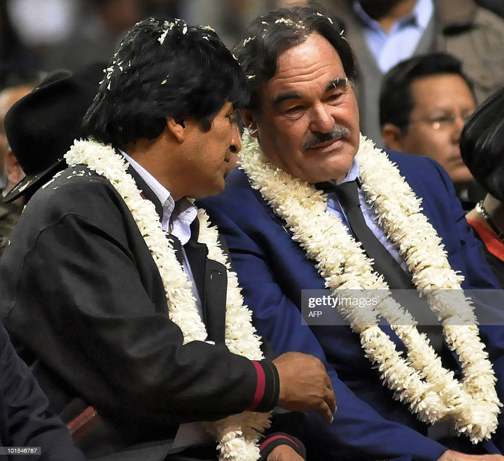 Bolivian President Evo Morales (L) speaks with US film director Oliver Stone in Cochabamba on June 1, 2010. Stone arrived in Cochabamba to present his new documentary 'South of the Border' and advised left-wing Latin American presidents, such as Morales and Venezuela's Hugo Chavez, to use the internet more, in attempt to spread their messages and counterrest the image that they are given by the press in the US.