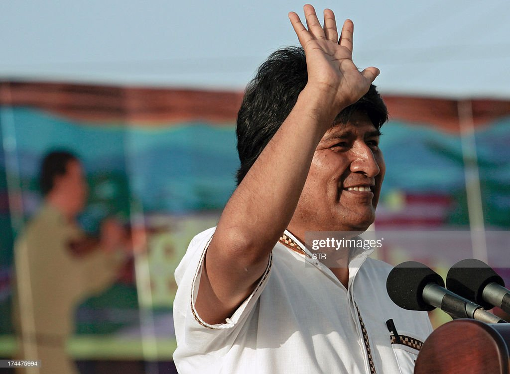 Bolivian President Evo Morales waves at the crowd as he delivers a speech on July 26, 2013, during celebrations of the 60th Anniversary of Moncada barrack attack in Santiago de Cuba. Cuba on Friday launched 60th anniversary celebrations of ex-leader Fidel Castro's Moncada Barracks assault -- widely seen as the start to the country's communist revolution. The events, led by current President Raul Castro, kicked off in the courtyard of the former Moncada Garrison, where in 1953, a young Fidel Castro and more than 100 rebels attempted to overthrow the dictator Fulgencio Batista. The bid was unsuccessful, but Castro eventually toppled Batista in 1959, launching the Americas' only communist regime, which he ruled for five decades before stepping aside for health reasons in favour of his brother. At left, Nicaraguan President Daniel Ortega.
