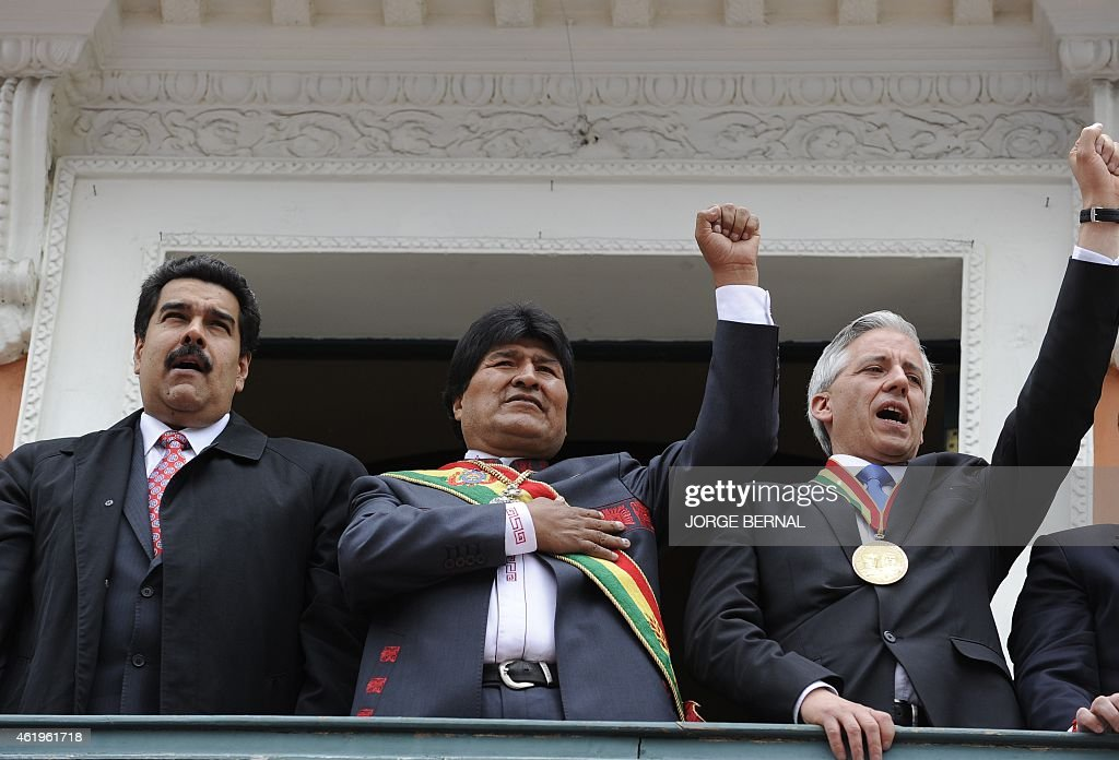 Bolivian reelected President <a gi-track='captionPersonalityLinkClicked' href=/galleries/search?phrase=Evo+Morales&family=editorial&specificpeople=272981 ng-click='$event.stopPropagation()'>Evo Morales</a> (C) and Vice-President <a gi-track='captionPersonalityLinkClicked' href=/galleries/search?phrase=Alvaro+Garcia+Linera&family=editorial&specificpeople=4606467 ng-click='$event.stopPropagation()'>Alvaro Garcia Linera</a> (R) gesture at the crowd next to Venezuela's President <a gi-track='captionPersonalityLinkClicked' href=/galleries/search?phrase=Nicolas+Maduro&family=editorial&specificpeople=767093 ng-click='$event.stopPropagation()'>Nicolas Maduro</a> from a balcony of the Quemado presidential palace in La Paz, after their swearing in ceremony for the third term, on January 22, 2015. Morales, Bolivia's first indigenous president, took the oath of office with his left fist raised 'on behalf of the Bolivian people and equality for all human beings.' The 55-year-old former coca grower, in office since 2006, was re-elected for a third mandate in October with 61 percent of the vote. His new term ends in 2020. AFP PHOTO / JORGE BERNAL
