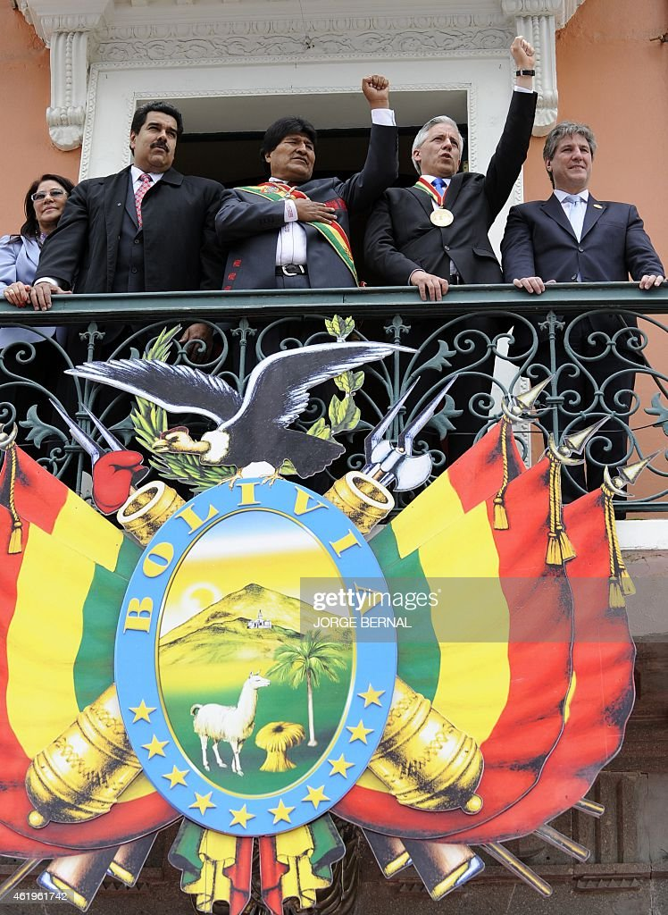 Bolivian reelected President <a gi-track='captionPersonalityLinkClicked' href=/galleries/search?phrase=Evo+Morales&family=editorial&specificpeople=272981 ng-click='$event.stopPropagation()'>Evo Morales</a> (C) and Vice-President <a gi-track='captionPersonalityLinkClicked' href=/galleries/search?phrase=Alvaro+Garcia+Linera&family=editorial&specificpeople=4606467 ng-click='$event.stopPropagation()'>Alvaro Garcia Linera</a> (2-R) gesture at the crowd next to Venezuela's President <a gi-track='captionPersonalityLinkClicked' href=/galleries/search?phrase=Nicolas+Maduro&family=editorial&specificpeople=767093 ng-click='$event.stopPropagation()'>Nicolas Maduro</a> (2-L) and Argentina's Vice-President Amado Boudou (R), from a balcony of the Quemado presidential palace in La Paz, after their swearing in ceremony for the third term, on January 22, 2015. Morales, Bolivia's first indigenous president, took the oath of office with his left fist raised 'on behalf of the Bolivian people and equality for all human beings.' The 55-year-old former coca grower, in office since 2006, was re-elected for a third mandate in October with 61 percent of the vote. His new term ends in 2020.