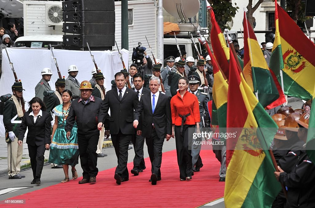 Bolivian reelected Vice-President, <a gi-track='captionPersonalityLinkClicked' href=/galleries/search?phrase=Alvaro+Garcia+Linera&family=editorial&specificpeople=4606467 ng-click='$event.stopPropagation()'>Alvaro Garcia Linera</a> (C, blue tie), accompanied by his wife Claudia Fernandez (R), heads to the National Congress to be sworn in for a third mandate along with president Evo Morales (out of frame), in La Paz, on January 22, 2015. Morales, Bolivia's first indigenous president, took the oath of office with his left fist raised 'on behalf of the Bolivian people and equality for all human beings.' The 55-year-old former coca grower, in office since 2006, was re-elected for a third mandate in October with 61 percent of the vote. His new term ends in 2020. AFP PHOTO / AIZAR RALDES