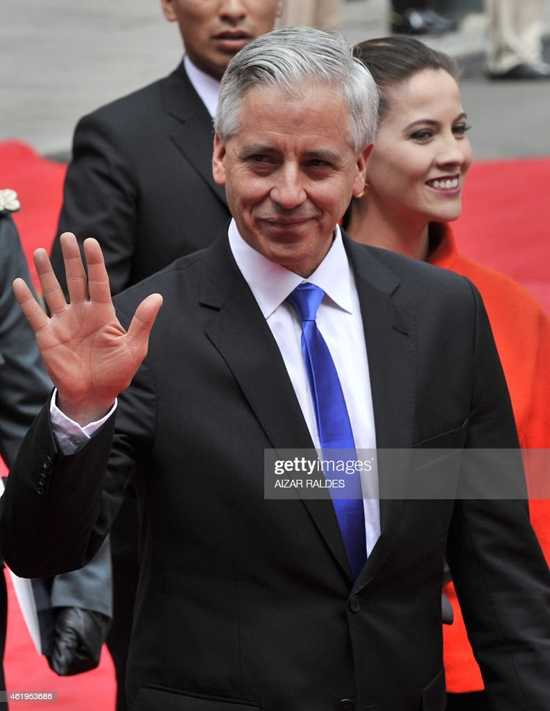 Bolivian reelected Vice-President, <a gi-track='captionPersonalityLinkClicked' href=/galleries/search?phrase=Alvaro+Garcia+Linera&family=editorial&specificpeople=4606467 ng-click='$event.stopPropagation()'>Alvaro Garcia Linera</a>, accompanied by his wife Claudia Fernandez (R), heads to the National Congress to be sworn in for a third mandate along with president Evo Morales (out of frame), in La Paz, on January 22, 2015. Morales, Bolivia's first indigenous president, took the oath of office with his left fist raised 'on behalf of the Bolivian people and equality for all human beings.' The 55-year-old former coca grower, in office since 2006, was re-elected for a third mandate in October with 61 percent of the vote. His new term ends in 2020. AFP PHOTO / AIZAR RALDES