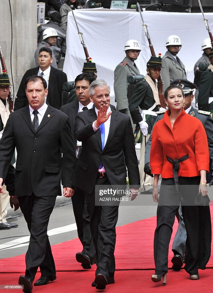 Bolivian reelected Vice-President, <a gi-track='captionPersonalityLinkClicked' href=/galleries/search?phrase=Alvaro+Garcia+Linera&family=editorial&specificpeople=4606467 ng-click='$event.stopPropagation()'>Alvaro Garcia Linera</a> (C), accompanied by his wife Claudia Fernandez (R), heads to the National Congress to be sworn in for a third mandate along with president Evo Morales (out of frame), in La Paz, on January 22, 2015. Morales, Bolivia's first indigenous president, took the oath of office with his left fist raised 'on behalf of the Bolivian people and equality for all human beings.' The 55-year-old former coca grower, in office since 2006, was re-elected for a third mandate in October with 61 percent of the vote. His new term ends in 2020. AFP PHOTO / AIZAR RALDES