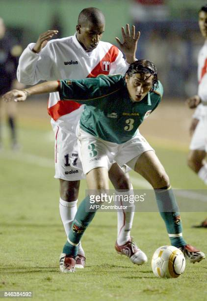 Bolivian Sergio Jauregui fights for the ball with Peruvian Jefferson Farfan 06 July 2004 at the Nacional stadium in Lima during their Copa America...