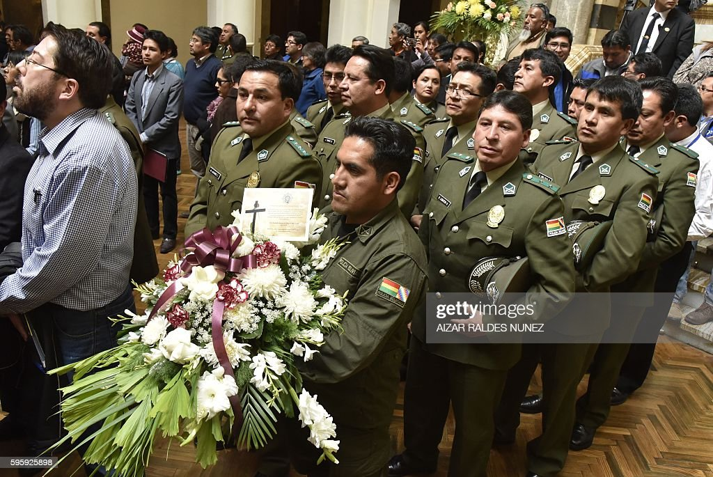 Bolivian soldiers arrive with wreaths during the wake of deputy interior minister Rodolfo Illanes at the presidential Quemado Palace in La Paz on...